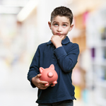 Boy holding piggy bank
